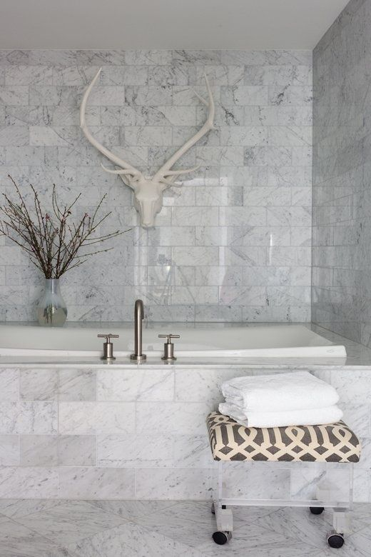 a white marble bathroom done with tiles - an amazing idea to use if you arne't ready to splurge on real marble