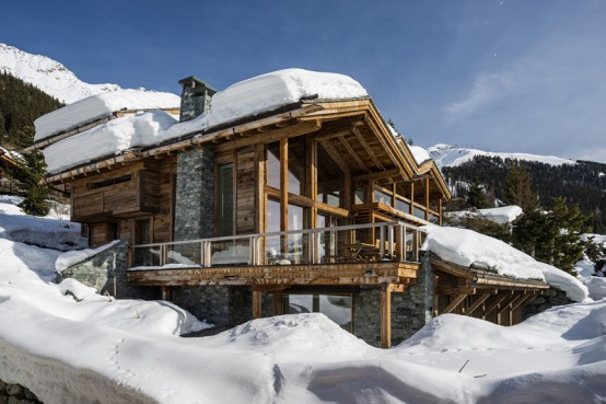 Luxurious swiss chalet with lots of wood and stone digsdigs for Ski chalet home designs
