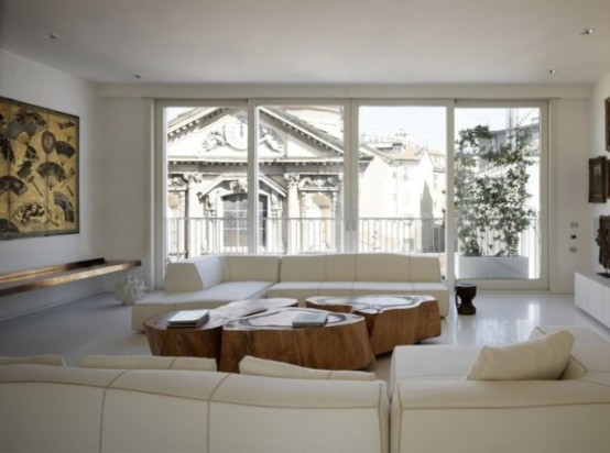 Luxurious White Apartment With Sculptural Wood And Stone Objects