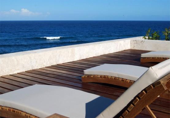 Modern-sunbeds-design-in-white-with-view-of-the-ocean