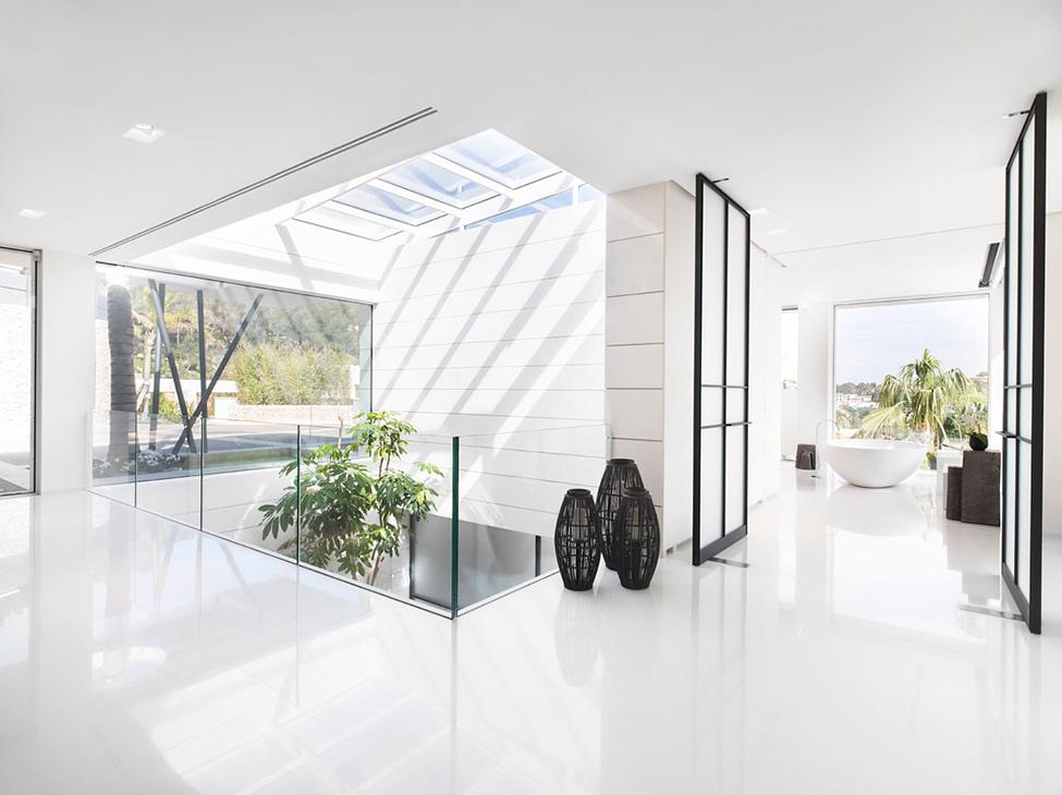 Luxury Villa Chameleon With A Glossy White Interior