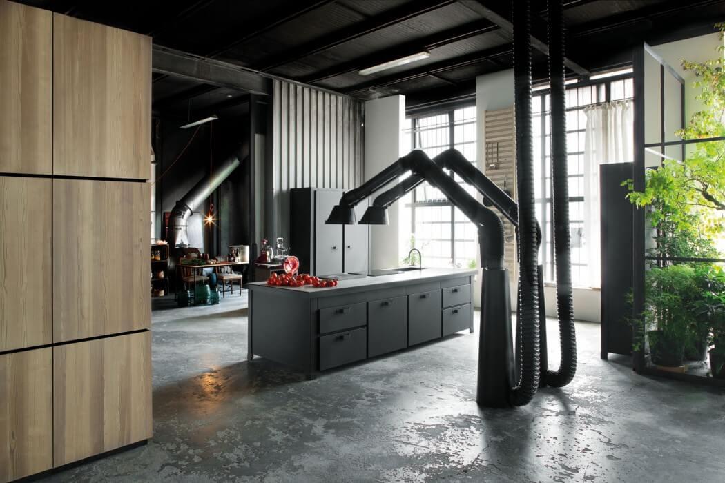 Picture Of milan industrial loft with dark industrial metals in decor  2