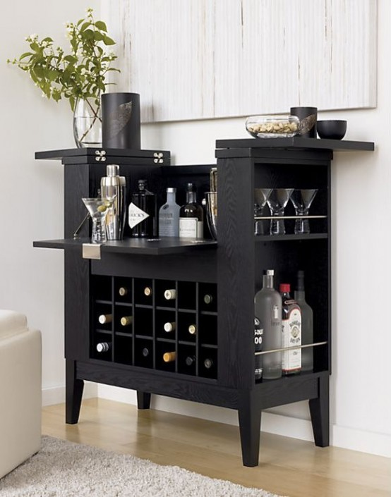 a black home mini bar with plenty of storage space, greenery, lots of bottles and other stuff