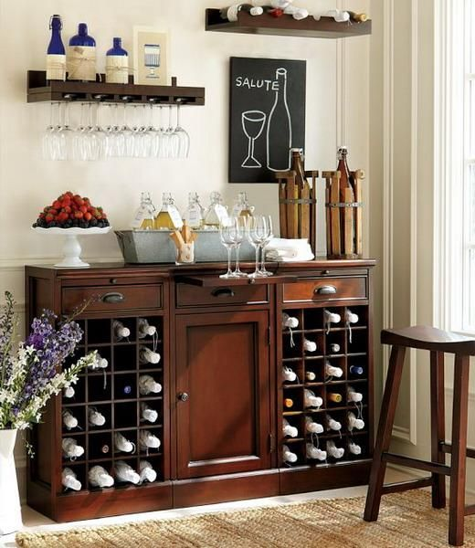 an elegant dark stained vintage home bar with closed and open storage compartments and matching open shelves over it creates a whole bar space