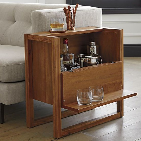 a wooden side table that doubles as a home bar is a cool piece that won't take much space and will give you enough space for drinks