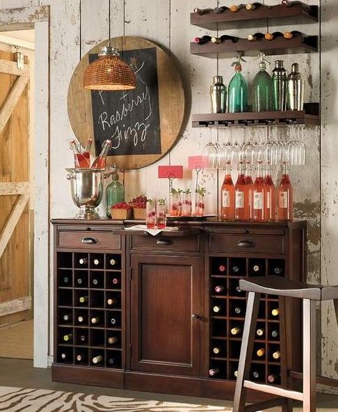 a dark stained vintage-inspired wooden bar and some matching open shelves over it plus a chalkboard sign