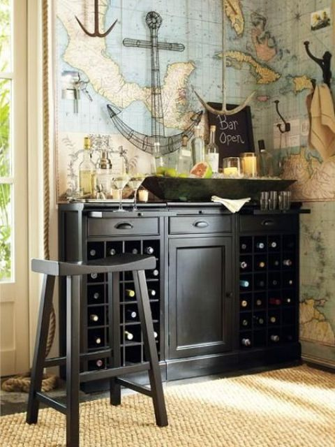 an elegant vintage bar of dark wood with open and closed storage compartments and a bar stool for a vintage feel