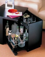 a black side table with a built-in home bar inside is a very smart idea to save some space in your home