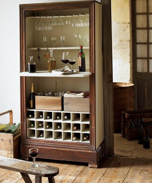 a dark stained vintage home bar with open and closed storage compartments looks chic and refined