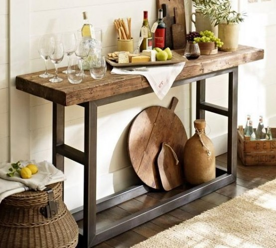 a simple home bar of a rustic wooden console table with greenery, some wine and appetizers is perfect