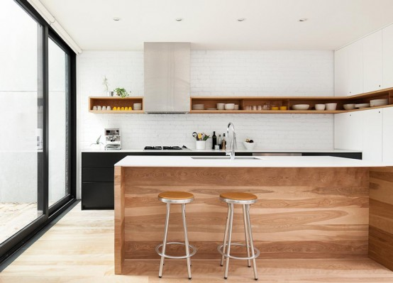Minimal Black And White Kitchen With A White Brick Wall