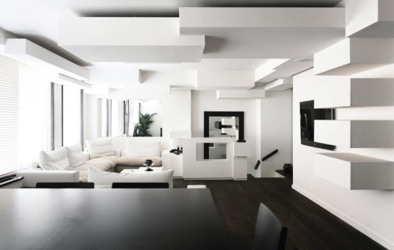 Monochrome Duplex Apartment With Complex Interior Geometry
