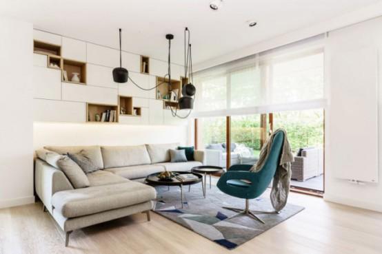 Minimalist Apartment With Creative Storage And Graphic Decor