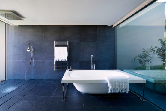 Minimalist Bathroom With A Glass Wall