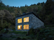 minimalist-cabin-covered-with-stone-from-ruins-17