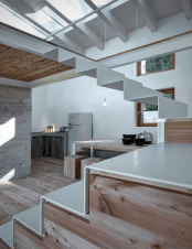 minimalist-cabin-covered-with-stone-from-ruins-3