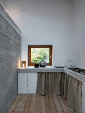 minimalist-cabin-covered-with-stone-from-ruins-5
