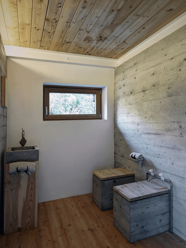Picture Of minimalist cabin covered with stone from ruins  7