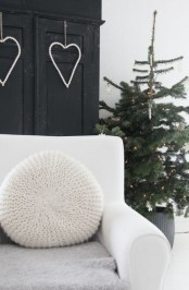 a Nordic Christmas tree with neutral ornaments, wooden bead hearts for minimalist Christmas decor