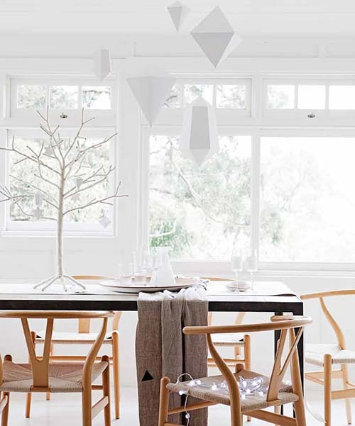 white 3D paper ornaments hanging over the table will give a slight minimalist and holiday feel