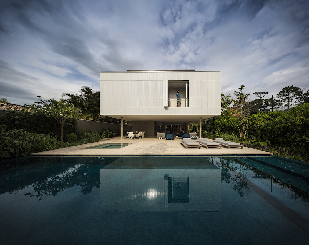 Tropical home designs archives digsdigs for Minimalist concrete house