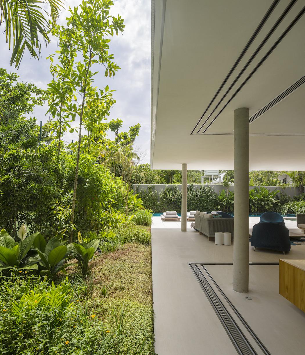 Picture Of minimalist concrete casa branca in the tropics  3