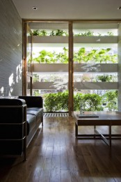 Minimalist Concrete House With A Large Vertical Garden