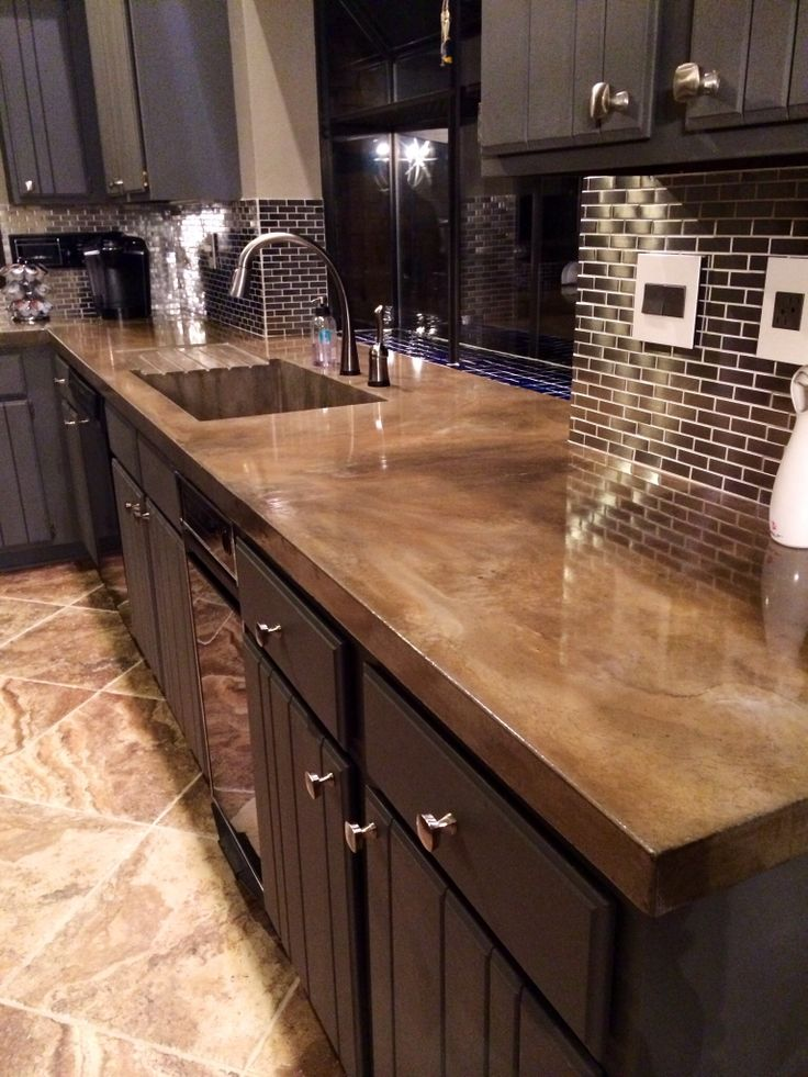 a midnight blue kitchen with concrete countertops and a shiny finish that will keep all the stains off