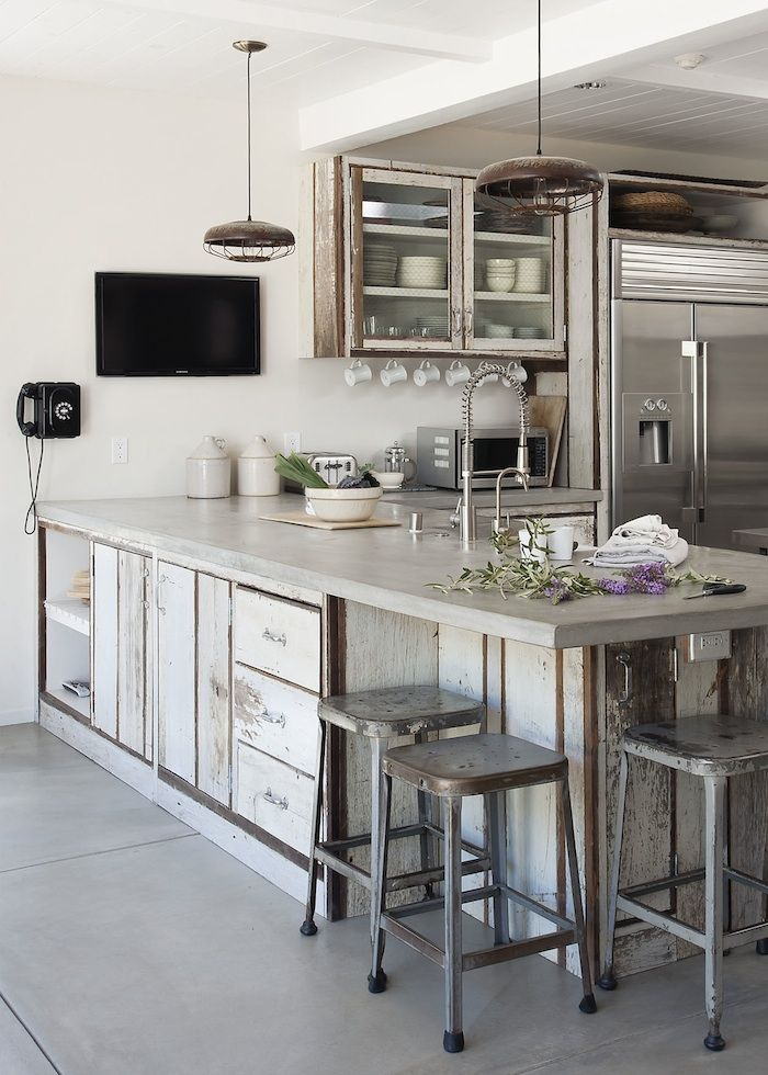 an eclectic kitchen with shabby chic neutral cabinets done with concrete countertops, with shabby chic stools and shabby chic and modern lamps