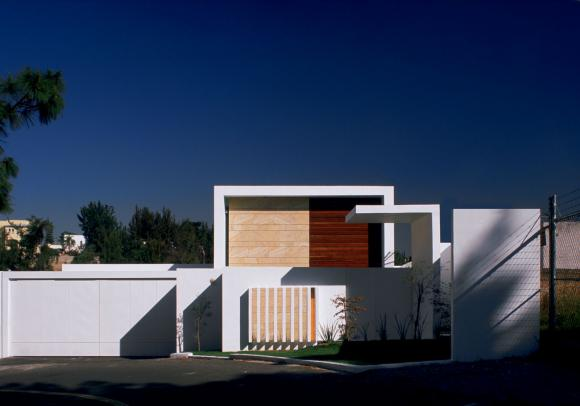 Minimalist house divided on two layers cube house by for Modern minimalist architecture