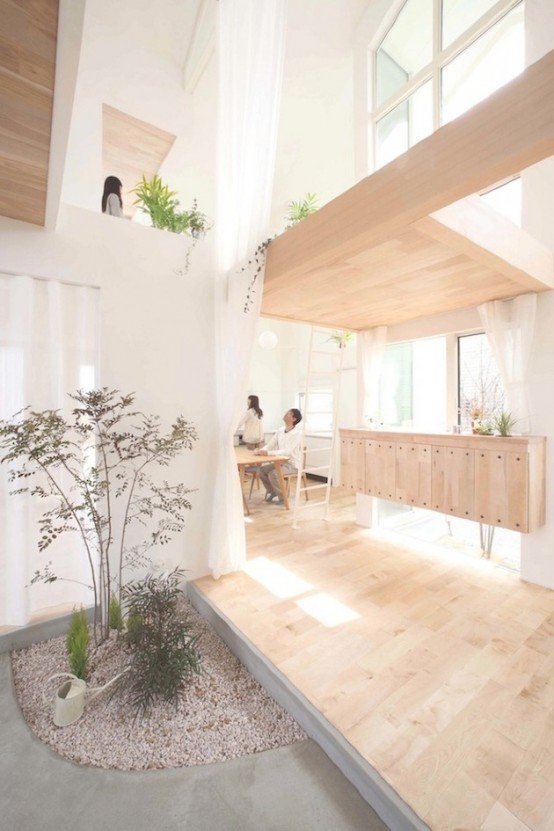Minimalist House With Trees Planted Inside