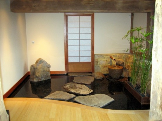 a meditation space with an inner pond, rocks, potted greenery for more relaxation