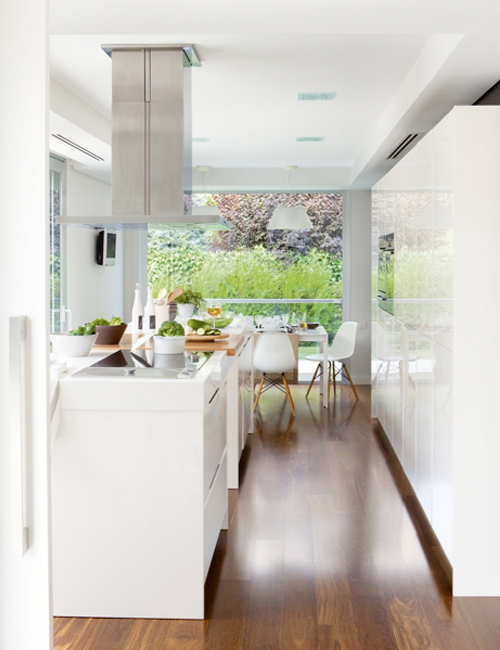 Minimalist White Kitchen With A Summer Feel