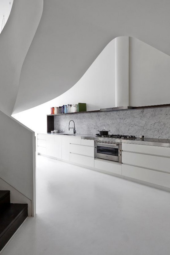 Minimalist White Loft Design With Sculptural Accents