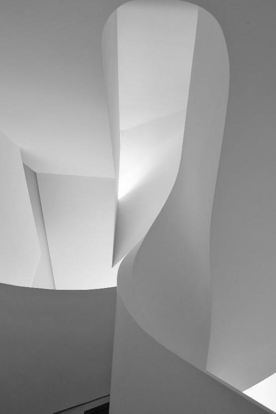 Minimalist White Loft Design With Sculptural Accents