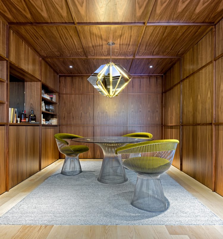 A cool hanging lamp accentuates the table area