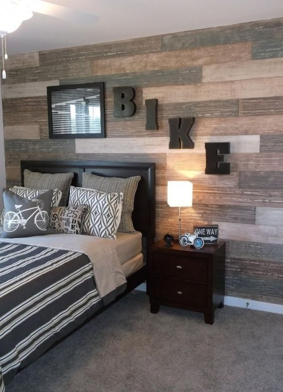 A shabby wood accent wall is a great way to spice things up in a teenage boy's room.