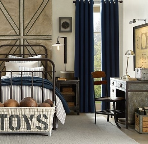 This cozy and inviting boy's room features some awesome industrial-style vintage-looking decorations that make it looks quite stylish.