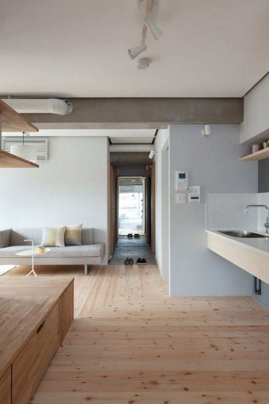 Modern Apartment Renovation With An L Shaped Wooden Wall