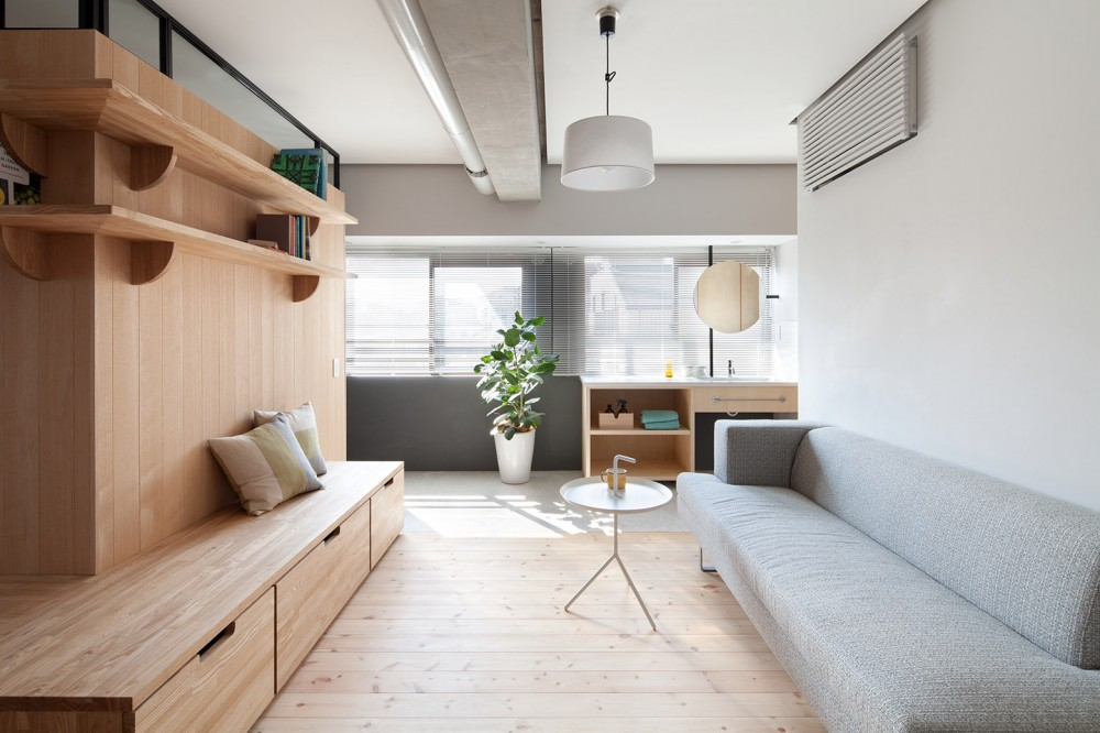 Modern apartment renovation with an l shaped wooden wall digsdigs - Renovating an apartment ...