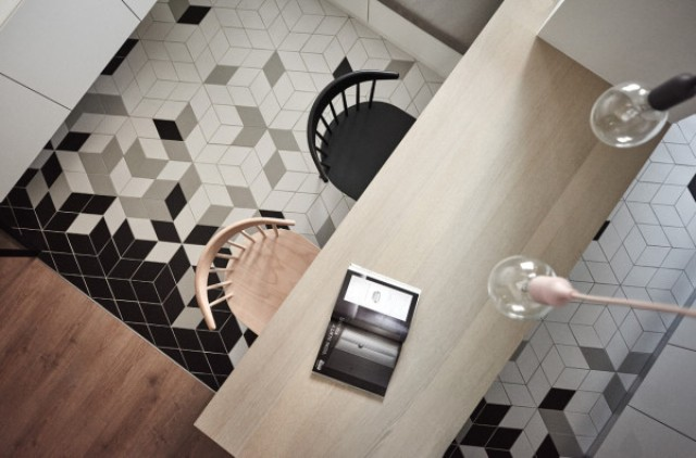 Stylish diamond-shaped tiles define the area