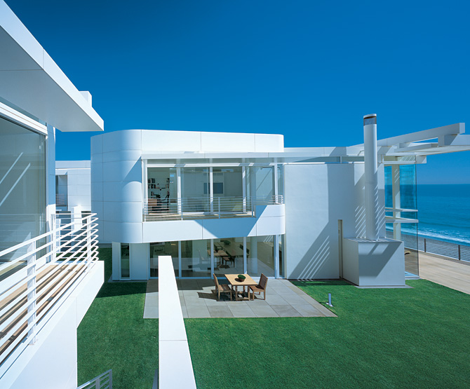 modern beach house with white exterior paint by richard
