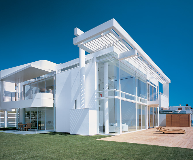 Modern beach house with white exterior paint by richard for Beach style home plans