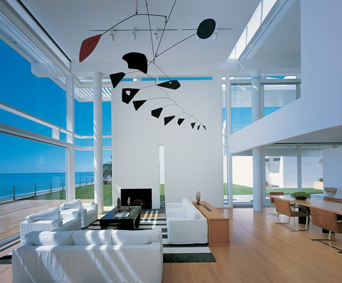 Modern beach house with white exterior paint by richard meier digsdigs Interior design ideas for beach home