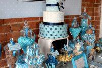 modern blue dessert table for a boy baby shower