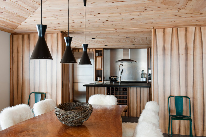 Picture Of modern chalet with wood clad interiors and touches of green  5