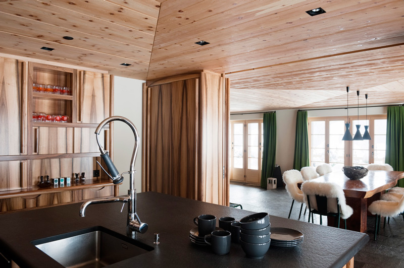 Picture Of modern chalet with wood clad interiors and touches of green  6