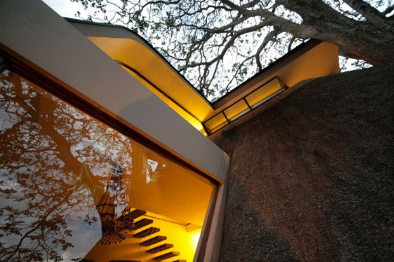 Modern Curved Extension Of A Traditional House