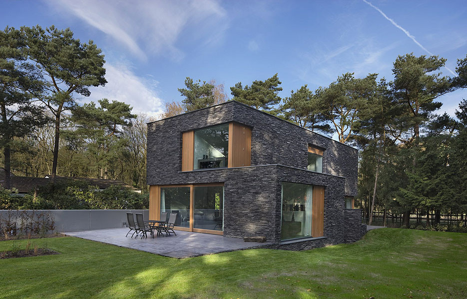Modern forest house finished with stone bosvilla soest by zecc
