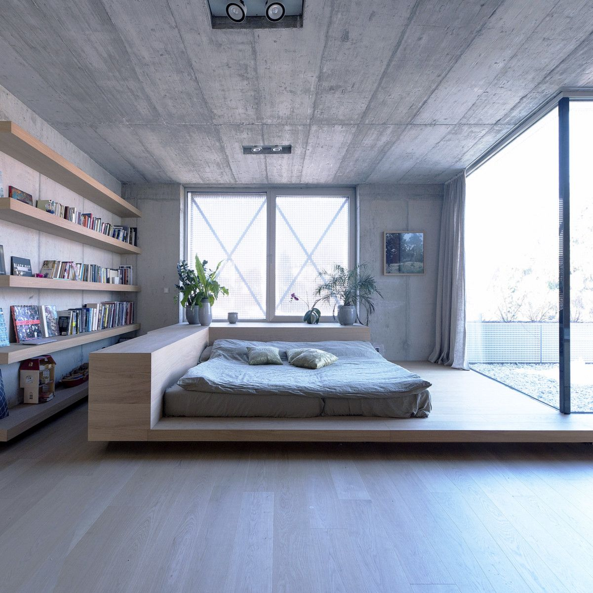 integrate your home library into your bedroom   place floating bookshelves on the wall and voila